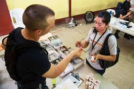 u s department of defense photo essay u s navy seaman adam simao helps a patient choose frames for a pair of glasses at