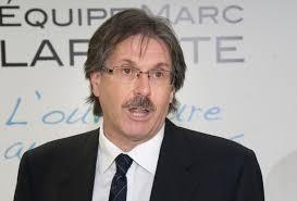 Le candidat Marc Laporte croit que des liens existent entre les équipes de Sylvie Surprenant et Vincent Arseneau. - 1380673938359_ORIGINAL