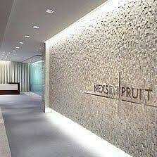 plaster behind reception wall between with company name written architect office aarchitect office hideki
