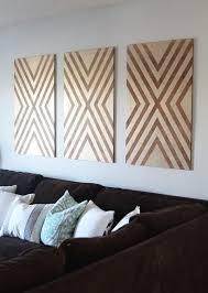 plywood decor chelsea coulston of making home base just used plywood and stain to create these bold wall hangings just click through for the