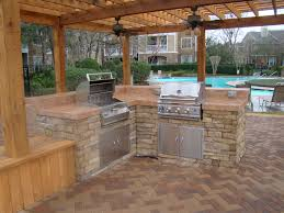 patio outdoor stone kitchen bar: outdoor kitchen design ideas elegant outdoor kitchen with ceiling fans simple patio with l shape cabinet