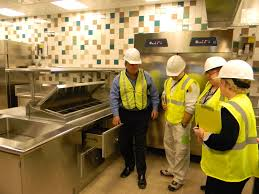 commercial kitchen a rep shows parkview s kitchen manager and a few team members how to properly use a