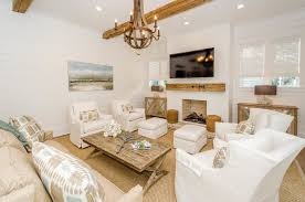 splashy sunbrella pillows in living room beach style with beach living room furniture next to brown sofa living room alongside ceiling beams and beige sofa beachy style furniture