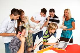 teenagers using technology in a group project