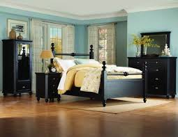 impressive black bedroom furniture wall color including small bedside cabinets with pewter drawer knobs below westclox alarm clock and brass table lamps black painted bedroom furniture
