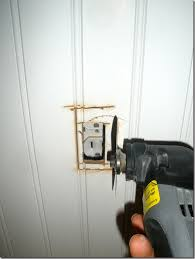 remove the outlet from the electrical box cabinet outlets switches