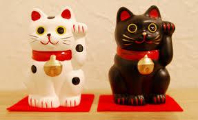 Resultado de imagen de gato chino moviendo la mano