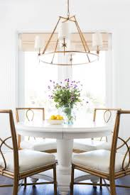 transitional dining chair sch: a white table with a bamboo chair with a very open back notice how all round tables have a round chandelier we would want to keep it quotopenquot so not to