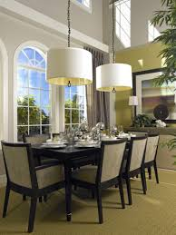 elegant square black mahogany dining table: elegant black dining room furniture set and contemporary drum shade chandeliers design plus tall arched windows