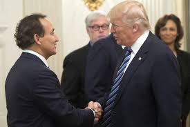 trump makes tempered pledge to support us carriers in face of gulf us president donald trump shakes hands oscar munoz l president and ceo of united airlines during a meeting airline industry executives in the
