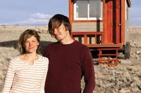 merete mueller and christopher smith of boulder stand in front of their 120 boulder tiny house front