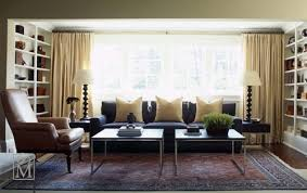 blue sofas living room: love the blue yellow color combo blue sofa and yellow silk pillows and drapes lovely built in shelves and cabinets blue yellow brown black living room