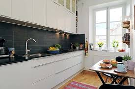 awesome scandinavian kitchen ideas with white kitchen cabinet and black ceramic backsplash also hardwood floor plus silver faucet and single bowl sink also awesome scandinavian ideas