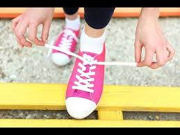 Image result for image of tying a shoelace
