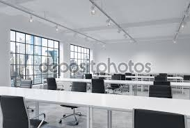 workplaces in a bright modern loft open space office empty tables and docents book bright modern office space