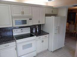 limestone tiles kitchen: traditional kitchen with limestone tile floors one wall hallmark arctic white cabinets