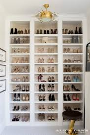 rows and rows of shoes and a fabulous semi flush mount light fixutre best lighting for closets