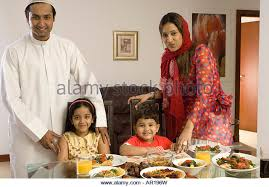 family dining table stock family of four at the dining table stock image