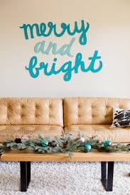 make this merry bright holiday wall art diy bright basement work space decorating