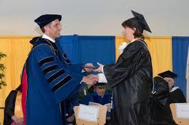 essay by president analyzing student handshakes on graduationamong