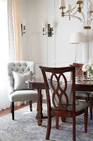 blue dining room features stacked decorative