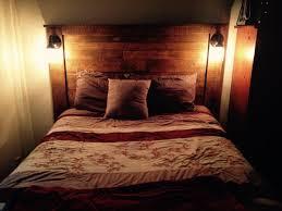 top headboard lighting on diy sturdy pallet headboard with scones lights headboard lighting bedroom headboard lighting