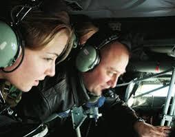 Cadet Jennifer MacLennan watches TSgt. Joe Riener operate the refueling boom. Robert Hubner - 2003Summer_gassing3_sm