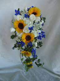 Wedding Flowers: Cascading bridal bouquet with colorful <b>yellow</b> ...