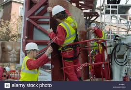 construction men worker road jobs new build under stock photo construction men worker road jobs new build under apprentice health and safety management building metal modern