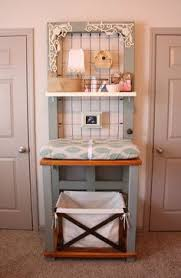 nursery with old door turned changing table we are past our days of needing a changing table but i love this idea for creating a really unique shelving baby nursery nursery furniture cool coolest