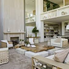 vaulted ceiling living room with huge coffee table on white stone pillars beautiful living room pillar