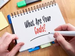 essential steps in your influencer marketing procedure curately a businessman writing the words what are your goals on a note pad
