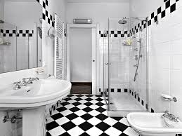 bathroom shower tile design color combinations: black and white tile patterns for this bathroom create a rock star color scheme the
