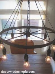 how to make a wagon wheel chandelier with mason jars rosepourpre home decor craft ideas pinterest wagon wheel chandelier wheel chandelier and wagon alternating length wagon wheel mason jar
