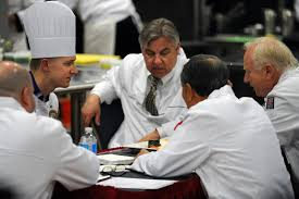 u s department of defense photo essay judges critique a culinary art competitor during the 2014 military culinary arts competition held on fort