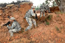 u s department of defense photo essay army sgt nicholas richmond center rounds the corner of a wall as he