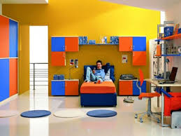 themed kids room designs cool yellow: bedroom wonderful yellow orange blue wood modern design wall cabinet wood bed orange mattres round carpet desk typist chairs interior at bedroom as well