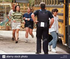 columbine high school students run to the safety of buses after columbine high school students run to the safety of buses after being rescued by swat teams from inside the high school after escaping from the school where