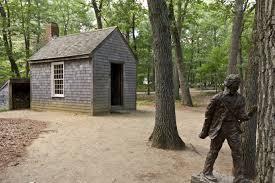 henry david thoreau replica of thoreau s cabin and a statue of him near walden pond