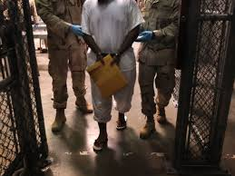 gitmo dilemma force feeding violates international law msnbc file photo u s navy guards escort a detainee after a life skills class