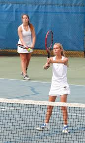 rain halts play in st round of a east regional tennis the fike s anna blair thomas background prepares to serve as doubles teammate jena hebbard gets