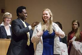 Clad in White, a Collective Rite: <b>Nursing</b> Holds First <b>White Coat</b> ...
