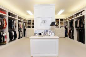 bedroom light brown solid wood double door panel dresser master closet organization drawers underneath beside open best closet lighting
