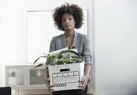 businesswoman packing up box in office after her employment was terminated write termination letter