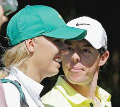 Rory McIlroy, of Northern Ireland, looks at tennis player Caroline Wozniacki during the annual Part 3 Contest, held the Wednesday before the Masters golf ... - 8223926