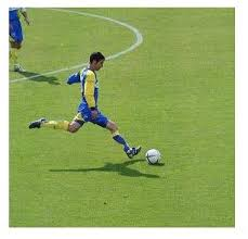 Image of soccer athlete kicking ball