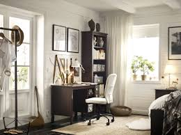 f modern home office design with brown varnished wooden wall closet organizer connected by writing desk equipped white upholstery fabric swivel chair best ikea furniture