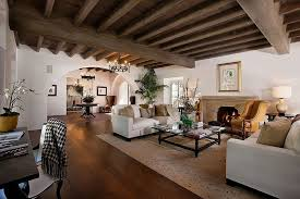 fascinating craftsman living room chairs furniture: craftsman living room with white walls large arched doorway and wood beam ceiling
