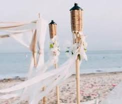 outdoor torch lighting. tiki torches lining the aisle of your beach wedding outdoor torch lighting d