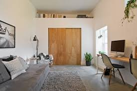 look salt lake city midcentury home office decorating ideas with beige wall black and white photography bookcase ledge concrete floor gray shag rug gray black shag rug home office